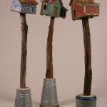 "Barn Trio 2005 wood, steel, paint, cement 61""x12""x12"""