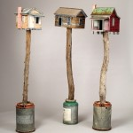 "Bird House Trio 1998-2003 wood, steel, cement, paint each 61""x16""x12"""