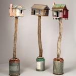 "Bird House Trio 1998-2003 wood, steel, cement, paint each 61""x16""x12"""