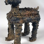 "Sheep Dog 2009 cast iron, patina 7""x4""x6"""